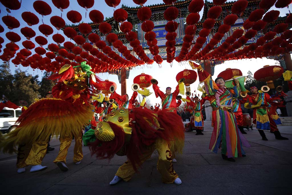Traditional dancers perform lion dance during the opening of the temple fair for celebrating the Chinese New Year at Ditan Park, also known as the Temple of Earth, in Beijing